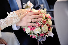 Bride and groom's hands with wedding rings Stock Images