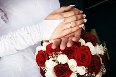 Bride and groom's hands with wedding rings. Stock Images