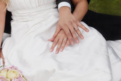 Bride and groom's hands with wedding rings Stock Photos