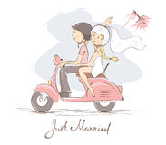 Bride and groom on a scooter Stock Photo