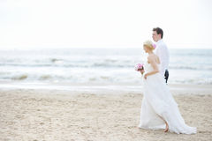 Bride and groom by the sea Stock Photo