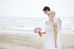 Bride and groom by the sea Royalty Free Stock Photos
