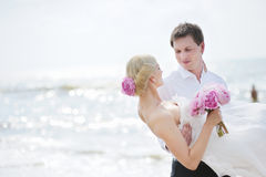 Bride and groom by the sea Royalty Free Stock Image
