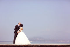 Bride and groom at sea Royalty Free Stock Photo