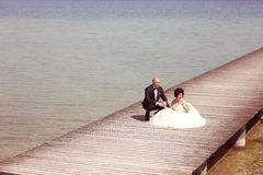 Bride and groom at sea Royalty Free Stock Images