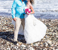 Bride and groom by the sea. On their wedding day Royalty Free Stock Photography