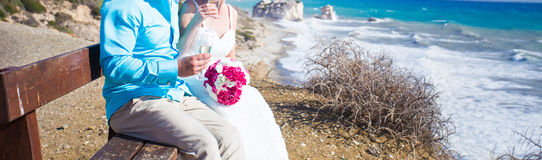 Bride and groom by the sea. On their wedding day Royalty Free Stock Photos