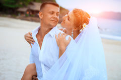 Bride and groom by the sea on their wedding day. Happy together Royalty Free Stock Images