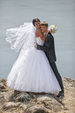 Bride and groom by the sea. Wedding: bride and groom by the sea Royalty Free Stock Photo