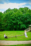 Bride, Groom And Seesaw Royalty Free Stock Photos