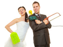 Bride and groom sharing household duties Royalty Free Stock Images