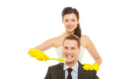 Bride and groom sharing household duties Royalty Free Stock Image