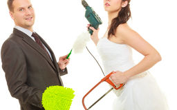 Bride and groom sharing household duties Royalty Free Stock Photography