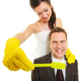 Bride and groom sharing household duties Stock Photo