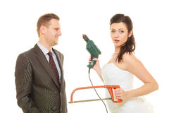 Bride and groom sharing household duties Stock Image