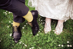 Bride and groom shoes. Focus on bride and groom shoes Stock Photos