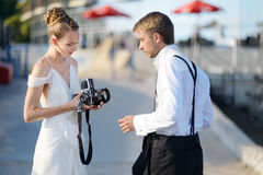 Bride and groom shooting with an old camera Royalty Free Stock Photography