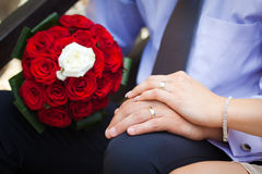 Bride and groom showing the engagement rings Royalty Free Stock Image