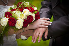 Bride and groom showing their rings Stock Photography