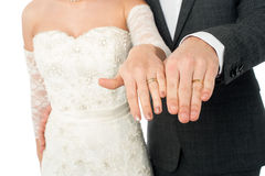 Bride and groom showing their wedding rings Stock Image