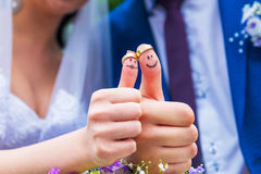 Bride and groom showing thumbs up Stock Image