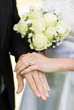 Bride and groom showing wedding rings Royalty Free Stock Images