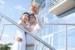 Bride and groom  shows into the distance  , young Royalty Free Stock Photography