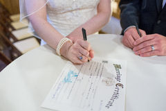 Bride and Groom Sign Wedding License Royalty Free Stock Photo