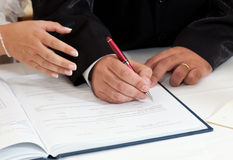 Bride and Groom Signing Marriage Certificate Royalty Free Stock Photo