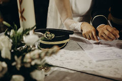 Bride and groom signing marriage document after wedding ceremony Stock Images
