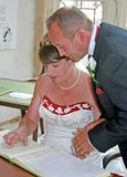 Bride and Groom signing the register Stock Images