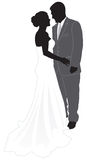Bride & Groom Silhouette. A silhouette of a bride & groom sharing an intimate moment Stock Photography