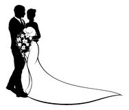 Bride and Groom Silhouette Wedding Concept. A bride and groom wedding couple in silhouette with in a bridal dress gown holding a floral bouquet of flowers Stock Photos