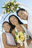 Bride and Groom with sister outdoors (portrait) Stock Image