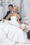 The bride and groom sit Stock Images