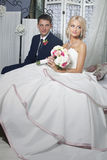 The bride and groom sit Royalty Free Stock Photography