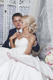 The bride and groom sit Royalty Free Stock Images