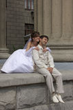 Bride and groom is sitting. On a steps of a Novosibirsk theatre, Siberia Stock Photos