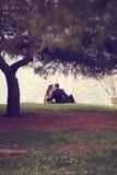 Bride and groom sitting at lake Royalty Free Stock Photo