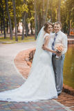 Bride and groom are sitting in the park Royalty Free Stock Image