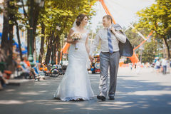 Bride and groom are sitting in the park Stock Photos