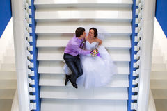 Bride and groom sitting on the stairs Stock Photography