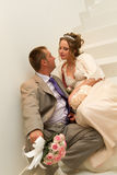 Bride and groom sitting on the stairs Royalty Free Stock Photography