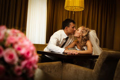 Bride and groom sitting in a stylish lounge Stock Images