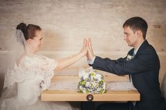 Bride and groom sitting table Royalty Free Stock Images