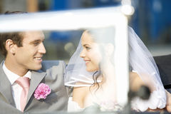 A bride and groom sitting in the wedding car Royalty Free Stock Photo