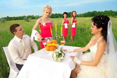 Bride and groom sitting at wedding table Stock Photos