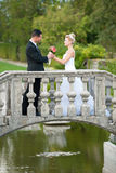 Bride and groom on a small bridge in park Royalty Free Stock Images