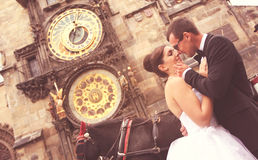 Bride and groom smiling in front of cathedral Stock Photography