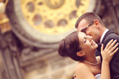 Bride and groom smiling in front of cathedral Royalty Free Stock Photos